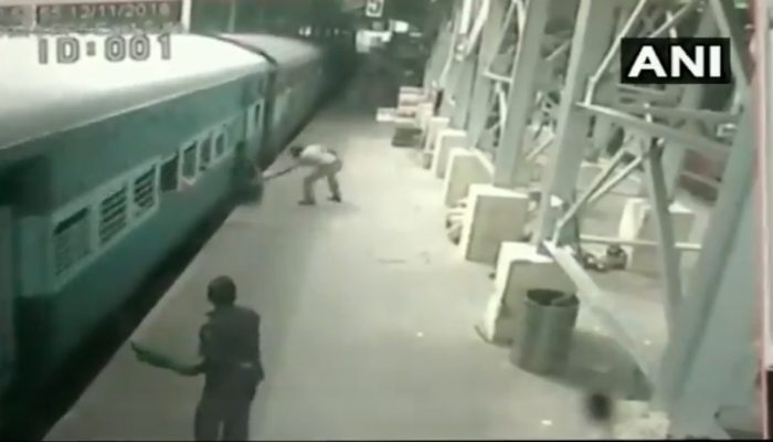 cop saves man from falling under train